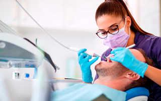 Черные точки на зубах: что это такое и как их убрать